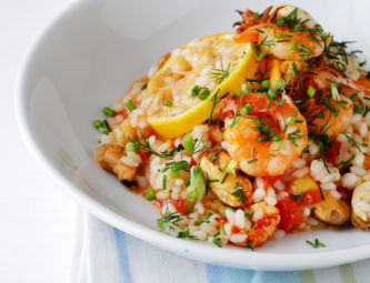 risotto with seafood sauce in bowl, food close-up